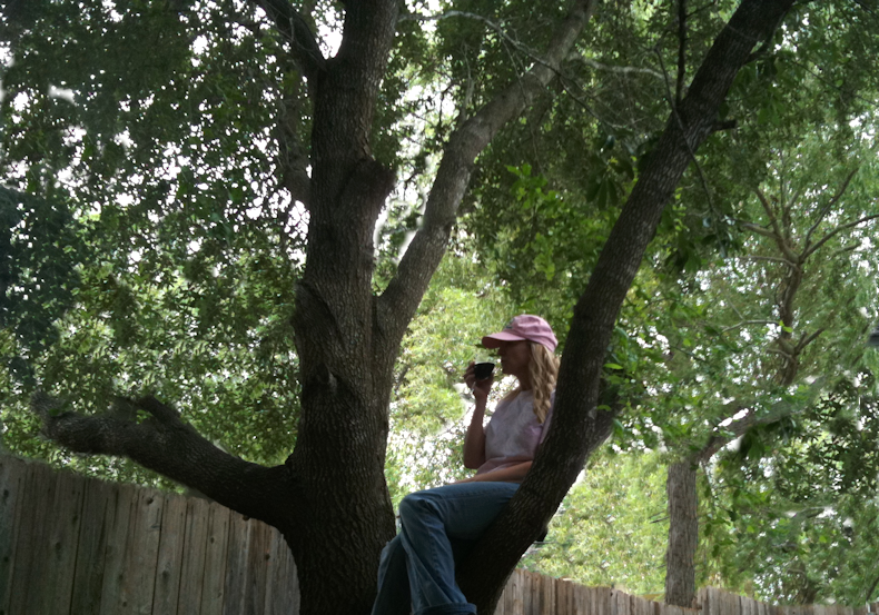 Jannie_drinks_wine_in_tree