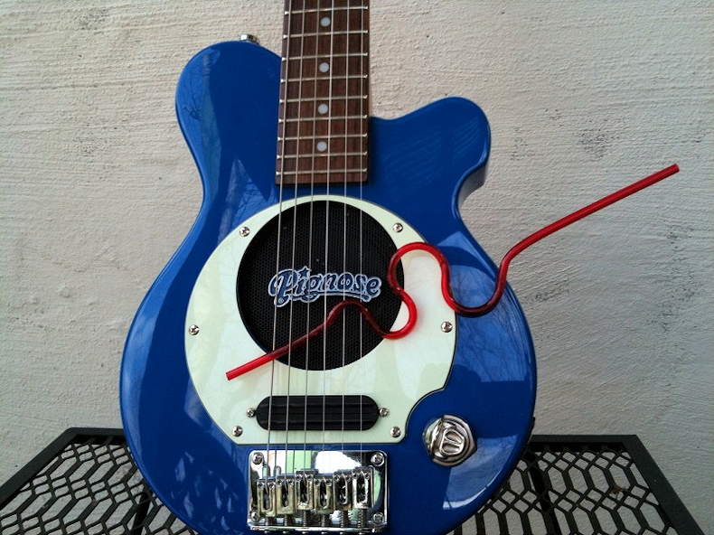 red_crazy_straw_blue_guitar